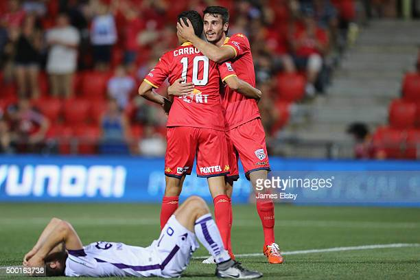 Marcelo Carrusca and George Mells of Adelaide celebrate their win during the round nine ALeague match between Adelaide United and Perth Glory at...