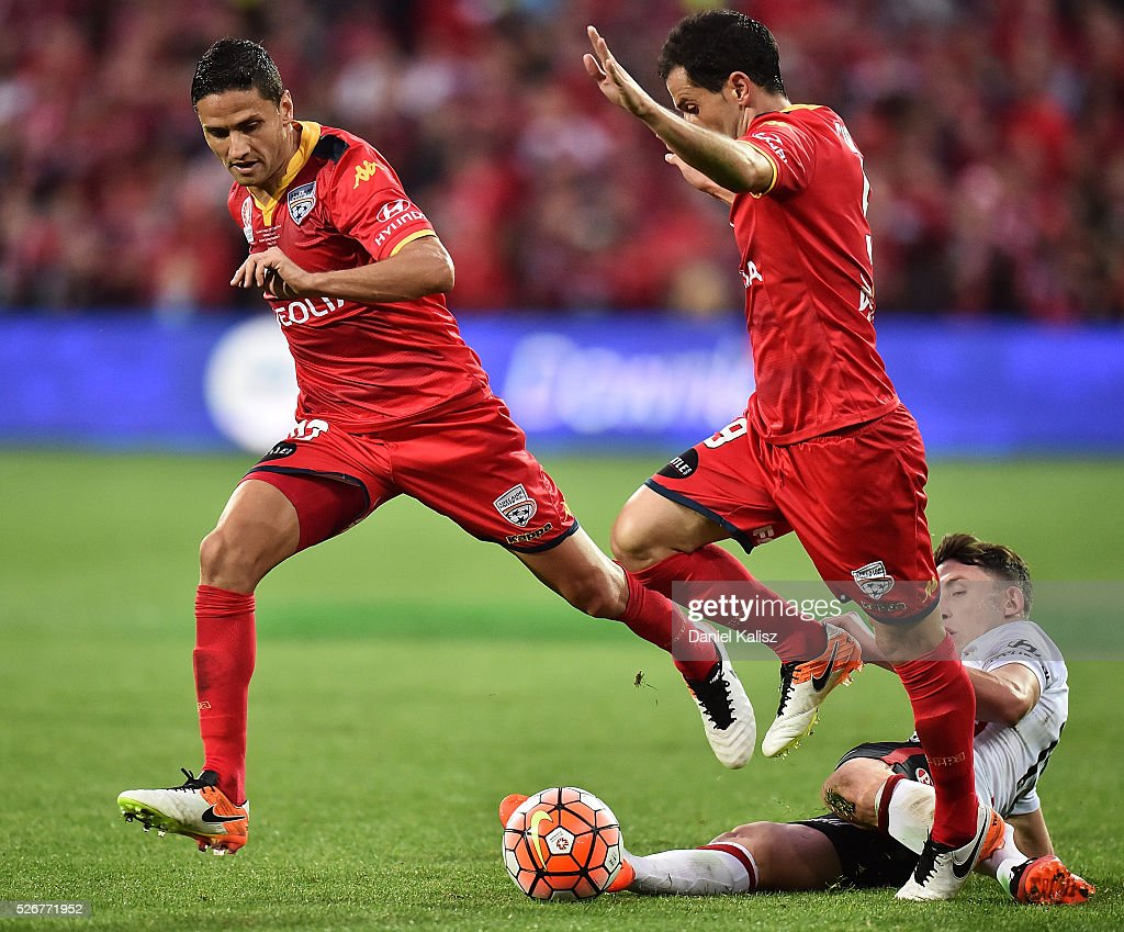 Marcelo Carrusca and Sergio Cirio of United look to gain control of the ball during the 2015/16 A-League Grand Final match between Adelaide United and the Western Sydney Wanderers at Adelaide Oval on May 1, 2016 in Adelaide, Australia.