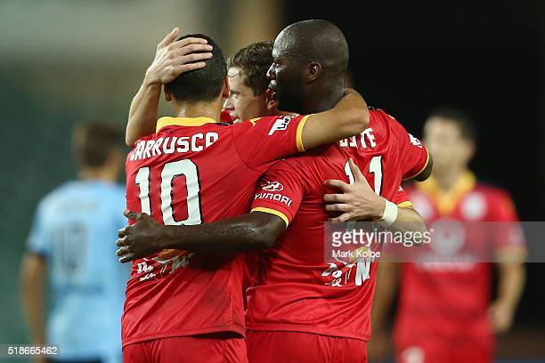 Marcelo Carrusca Craig Goodwin and Bruce Djite of Adelaide United celebrate Bruce Djite scoring a goal during the round 26 ALeague match between...