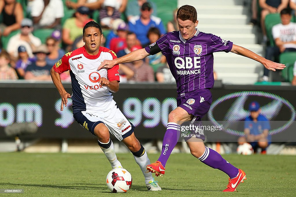 Marcelo Carrusca of Adelaide and Brandon O'Neill of the Glory contest for the ball during the round 11 A-League match between Perth Glory and Adelaide United at nib Stadium on December 22, 2013 in Perth, Australia.