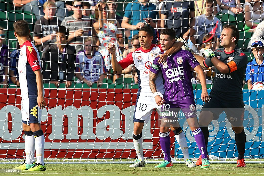 Marcelo Carrusca of Adelaide and Jamie Maclaren of the Glory jostle for position for a corner kick during the round 11 A-League match between Perth Glory and Adelaide United at nib Stadium on December 22, 2013 in Perth, Australia.