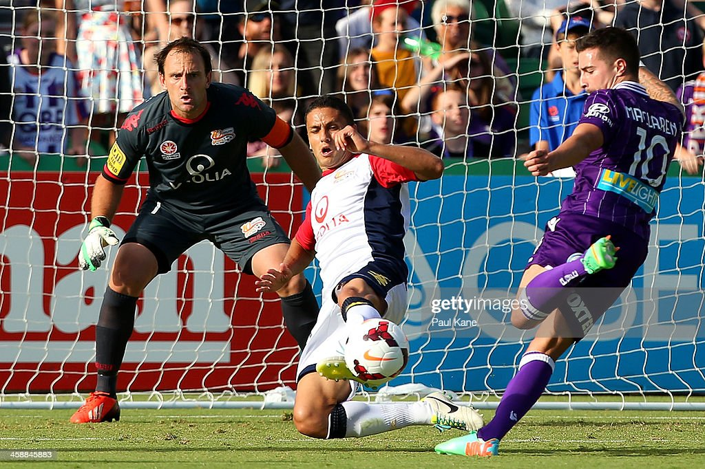 Marcelo Carrusca of Adelaide blocks a shot on goal by Jamie Maclaren of the Glory during the round 11 A-League match between Perth Glory and Adelaide United at nib Stadium on December 22, 2013 in Perth, Australia.