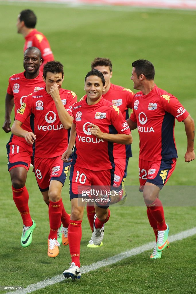 Marcelo Carrusca of Adelaide is joined by his teammates as he celebrates after scoring a goal during the round 26 ALeague match between Adelaide...