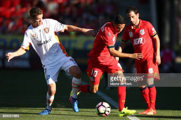 Marcelo Carrusca of Adelaide United competes for the ball with Thomas Kristensen of Brisbane Roar during the round 23 ALeague match between Adelaide...