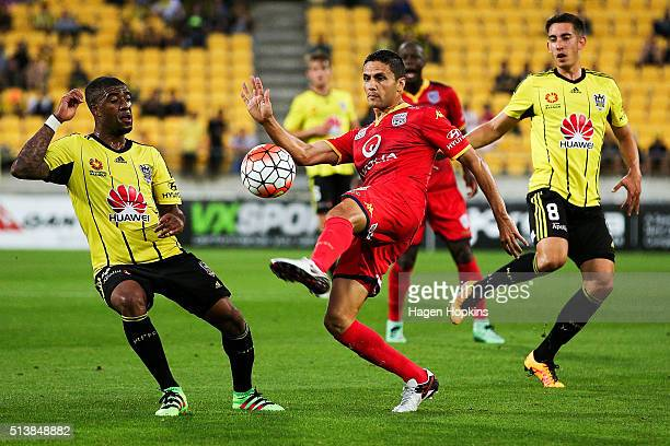 Marcelo Carrusca of Adelaide United controls the ball under pressure from Roly Bonevacia of the Phoenix during the round 22 ALeague match between the...