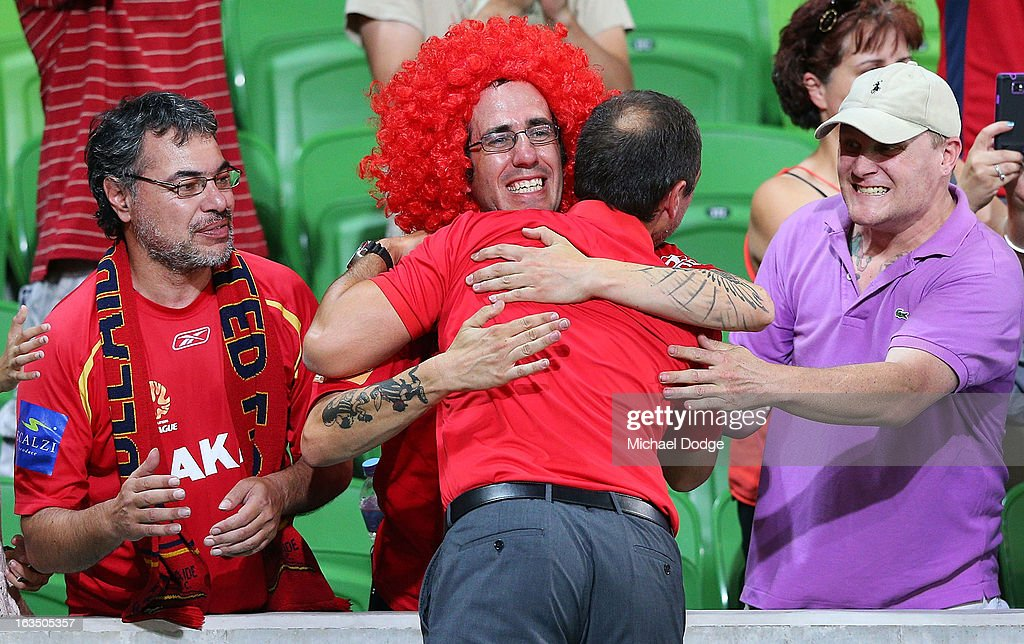 Marcelo Carrusca of Adelaide United gets a hug from a fan during the round 24 A-League match between the Melbourne Heart and Adelaide United at AAMI Park on March 11, 2013 in Melbourne, Australia.