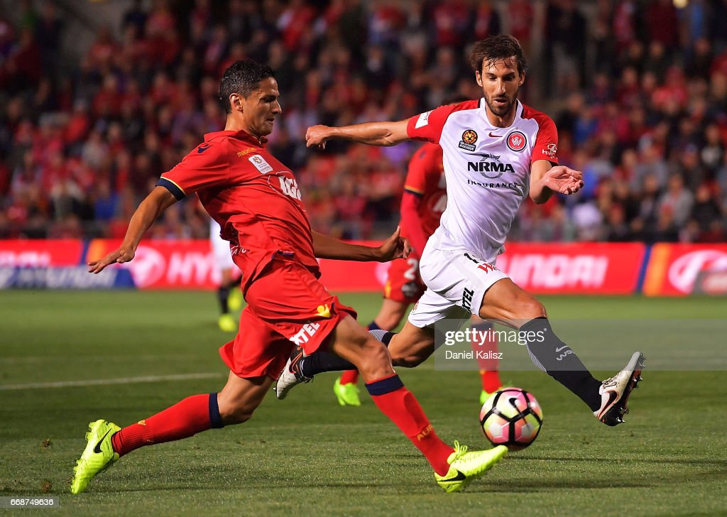 Marcelo Carrusca of United and Dimas of the Wanderers compete for the ball during the round 27 A-League match between Adelaide United and the Western Sydney Wanderers at Coopers Stadium on April 15, 2017 in Adelaide, Australia.