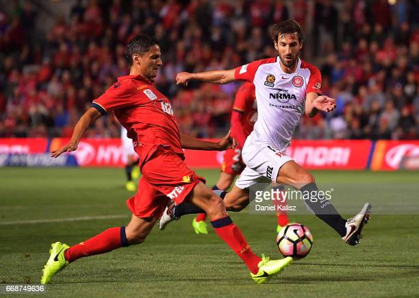Marcelo Carrusca of United and Dimas of the Wanderers compete for the ball during the round 27 ALeague match between Adelaide United and the Western...