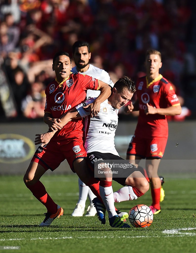 Marcelo Carrusca of United and Scott Jamieson of the Wanderers compete for the ball during the 2015/16 A-League Grand Final match between Adelaide United and the Western Sydney Wanderers at Adelaide Oval on May 1, 2016 in Adelaide, Australia.
