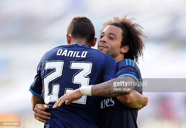 Marcelo celebrates with Danilo after scoring Real's 3rd goal during the La Liga match between Celta Vigo and Real Madrid at Estadio Balaidos on...