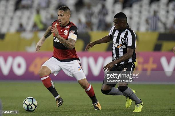 Marcelo Conceição of Botafogo battles for the ball with Guerrero of Flamengo during the match between Botafogo and Flamengo as part of Brasileirao...