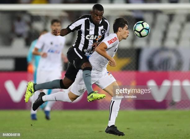 Marcelo Conceio of Botafogo struggles for the ball with Noguera of Santos during a match between Botafogo and Santos part of Brasileirao Series A...
