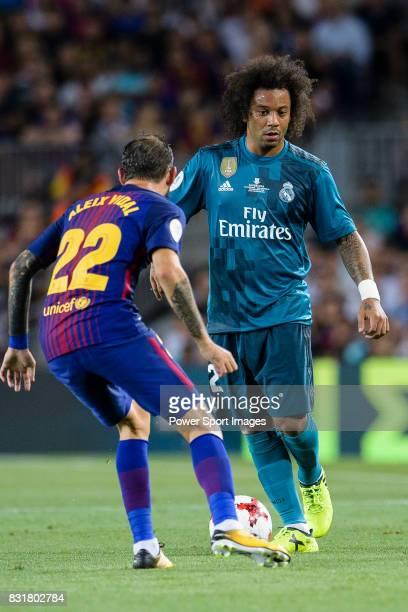 Marcelo da Silva of Real Madrid plays against Aleix Vidal of FC Barcelona during the Supercopa de Espana Final 1st Leg match between FC Barcelona and...
