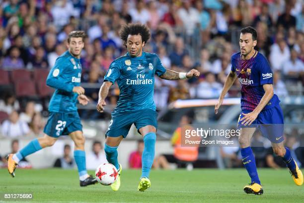 Marcelo da Silva of Real Madrid plays against Sergio Busquets of FC Barcelona during the Supercopa de Espana Final 1st Leg match between FC Barcelona...