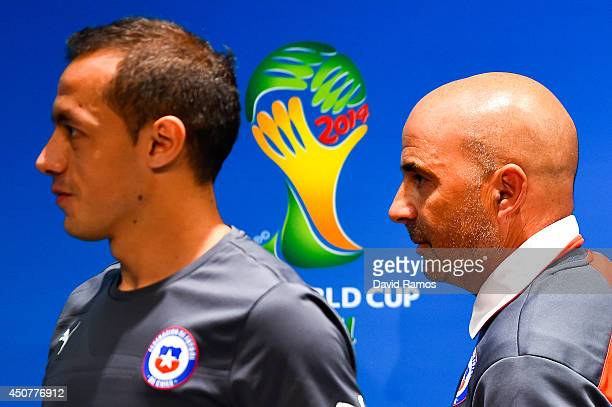 Marcelo Diaz and head coach Jorge Sampaoli of Chile leave the Chile press conference ahead of their 2014 FIFA World Cup Group B match against Chile...