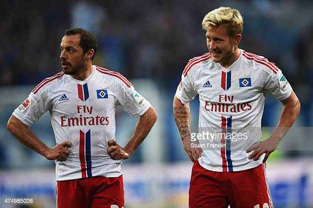Marcelo Diaz and Lewis Holtby of Hamburg look dejected during the first leg of the Bundesliga playoff match between Hamburger SV and Karlsruher SC at...