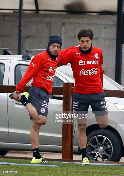 Marcelo Diaz and Miko Albornoz of Chile stretch during a training session at Juan Pinto Duran on July 01 2015 in Santiago Chile Chile will face...