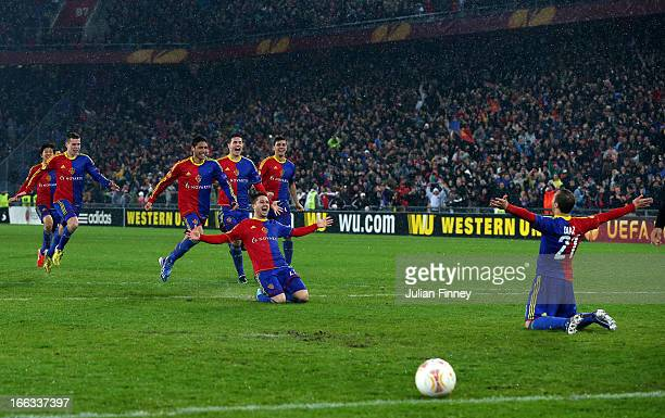 Marcelo Diaz of Basel celebrates with teammates after scoring the matching penalty during UEFA Europa League quarter final second leg match between...