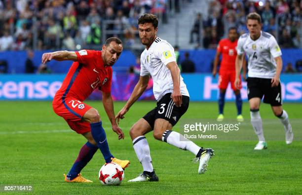 Marcelo Diaz of Chile and Jonas Hector of Germany battle for possession during the FIFA Confederations Cup Russia 2017 Final between Chile and...