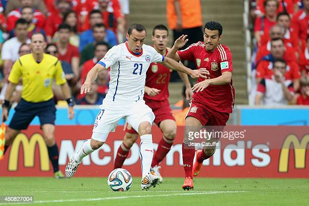 Marcelo Diaz of Chile and Pedro Rodriguez of Spain in action during the 2014 FIFA World Cup Brazil Group B match between Spain and Chile at Estadio...