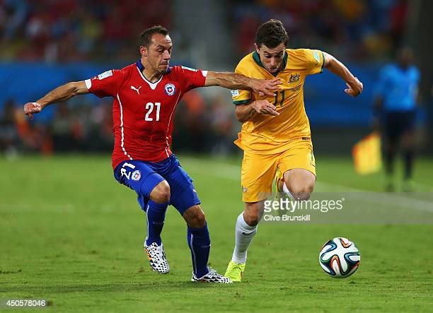 Marcelo Diaz of Chile and Tommy Oar of Australia battle for the ball during the 2014 FIFA World Cup Brazil Group B match between Chile and Australia...