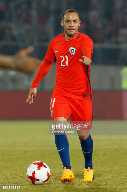 Marcelo Diaz of Chile controls the ball during a match between Chile and Burkina Faso as part of an International Friendly match at Nacional Stadium...