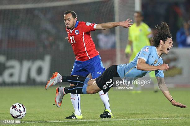 Marcelo Diaz of Chile fights for the ball with Edinson Cavani of Uruguay during the 2015 Copa America Chile quarter final match between Chile and...