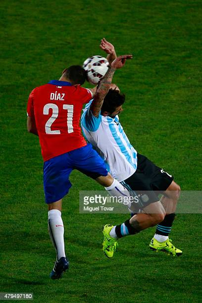 Marcelo Diaz of Chile goes for a header with Ezequiel Lavezzi of Argentina during the 2015 Copa America Chile Final match between Chile and Argentina...