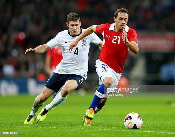 Marcelo Diaz of Chile is chased by Steven Gerrard of England during the international friendly match between England and Chile at Wembley Stadium on...