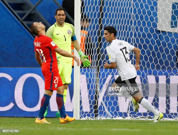 Marcelo Diaz of Chile national team and Claudio Bravo of Chile national team react as Lars Stindl of Germany national team celebrates his goal during...