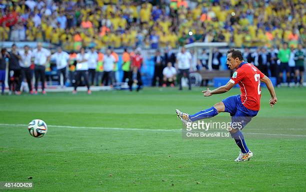 Marcelo Diaz of Chile scores during the penalty shoot out during the 2014 FIFA World Cup Brazil Round of 16 match between Brazil and Chile at Estadio...