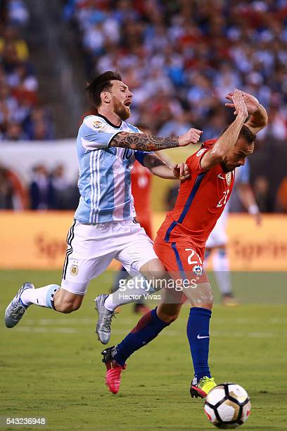 Marcelo Diaz of Chile struggles for the ball with Lionel Messi of Argentina during the championship match between Argentina and Chile at MetLife...