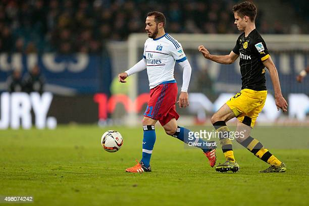 Marcelo Diaz of Hamburg and Julian Weigl of Dortmund compete for the ball during the First Bundesliga match between Hamburger SV and Borussia...