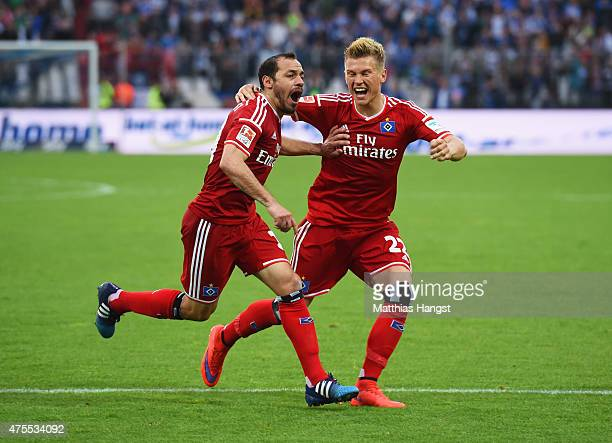 Marcelo Diaz of Hamburger SV celebrates with team mate Matthias Ostrzolek as scores their first and equalising goal from a freekick during the...
