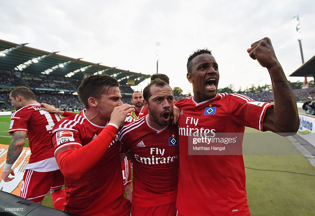 Marcelo Diaz of Hamburger SV celebrates with team mates as scores their first and equalising goal from a freekick during the Bundesliga playoff...