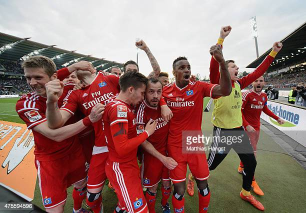 Marcelo Diaz of Hamburger SV celebrates with team mates as scores their first and equalising goal from a freekick during the second leg of the...