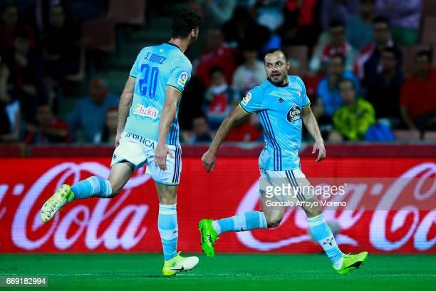 Marcelo Diaz of RC Celta de Vigo celebrates scoring their second goal with teammate Sergi Gomez during the La Liga match between Granada CF and Real...