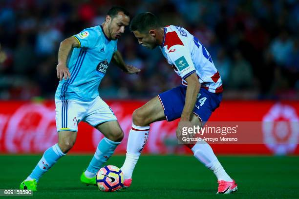 Marcelo Diaz of RC Celta de Vigo competes for the ball with Artem Anatoliovich Kravets of Granada CF during the La Liga match between Granada CF and...