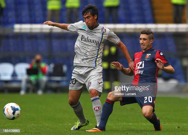 Marcelo Estigarribia of AC Chievo Verona competes for the ball with Sime Vrsaljko of Genoa CFC during the Serie A match between Genoa CFC and AC...