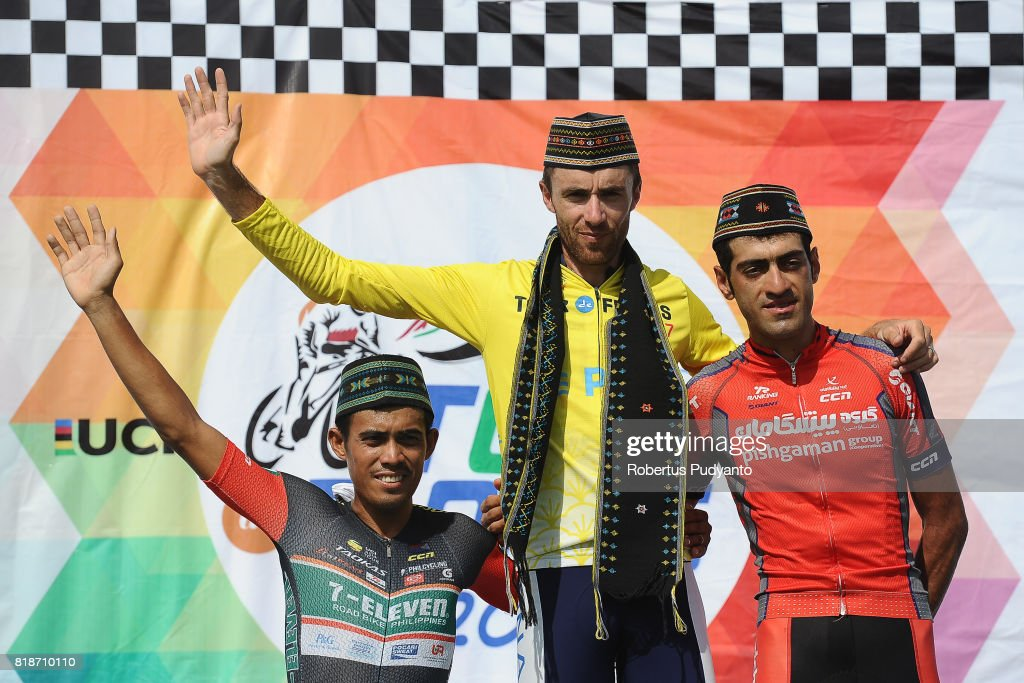 Marcelo Felipe of 7 Eleven Cycling Team Philippines (third position), yellow jersey winner Thomas Lebas of Kinan Cycling Team Japan, and Arvin Moazamigodarzi of Pishgaman Cyling Team Iran (runner-up) celebrate on the podium during Individul General Classification by Time awarding ceremony of the Tour de Flores 2017 on July 19, 2017 in Labuan Bajo, Flores, Indonesia.