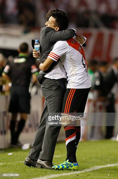 Marcelo Gallardo coach of River Plate and Leonel Vangioni of River Plate celebrate their team's first goal scored by Gabriel Mercado during a second...