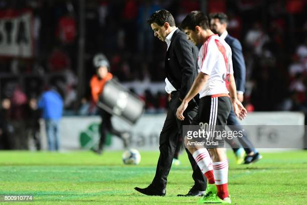 Marcelo Gallardo coach of River Plate and Luis Olivera leave the field after a match between Colon and River Plate as part of Torneo Primera Division...