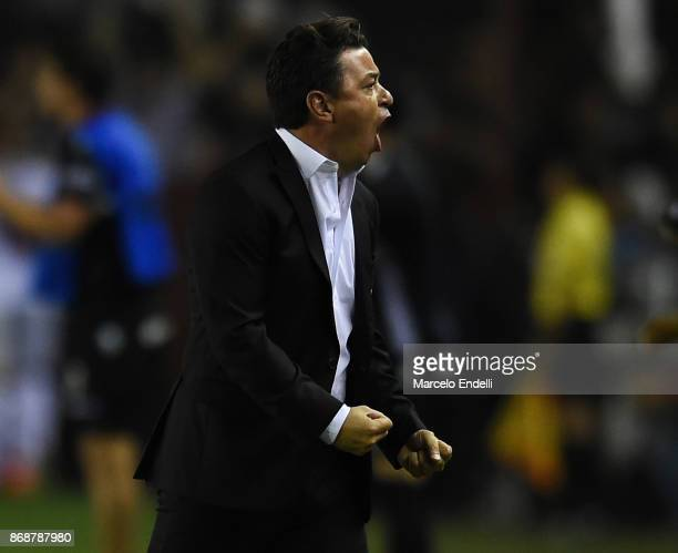 Marcelo Gallardo coach of River Plate celebrates after Ignacio Scocco scored the first goal of his team during a second leg match between Lanus and...