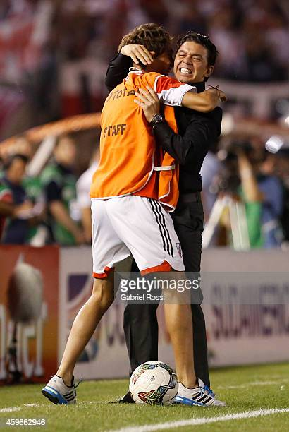 Marcelo Gallardo coach of River Plate celebrates with a staff member after Leonardo Pisculichi scoring the first goal of his team during a second leg...