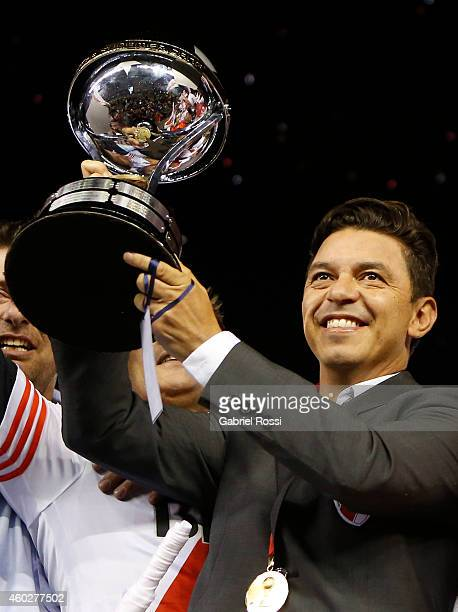 Marcelo Gallardo coach of River Plate celebrates with the trophy after wining the second leg final match between River Plate and Atletico Nacional as...