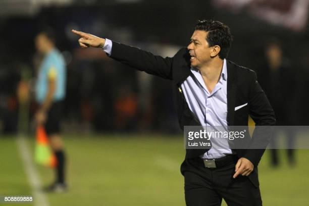 Marcelo Gallardo coach of River Plate gives instructions to his players during a first leg match between Guarani and River Plate as part of round of...