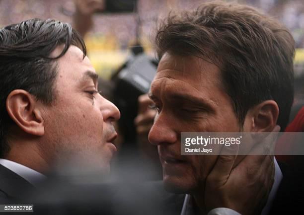 Marcelo Gallardo coach of River Plate greets Guillermo Barros Schelotto coach of Boca Juniors greet each other during a match between Boca Juniors...