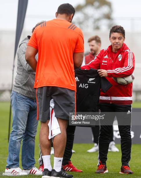 Marcelo Gallardo coach of River Plate receives a jersey from Patrick Tuipulotu of All Blacks during the New Zealand Rugby Championship Media Day...