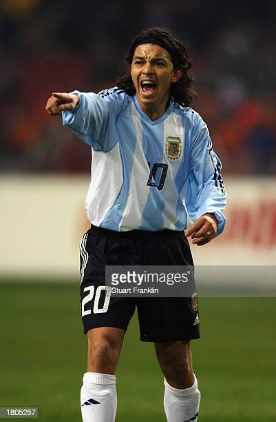 Marcelo Gallardo of Argentina signals to a team mate during the International friendly match between Holland and Argentina held on February 12 2003...