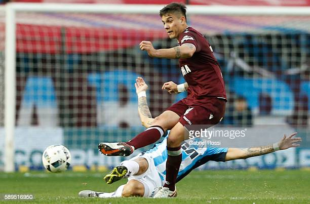 Marcelo Herrera of Lanus fights for the ball with Gustavo Bou of Racing Club during a match between Racing Club and Lanus as part of Copa del...
